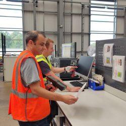 Oli and Matt in warehouse scanning