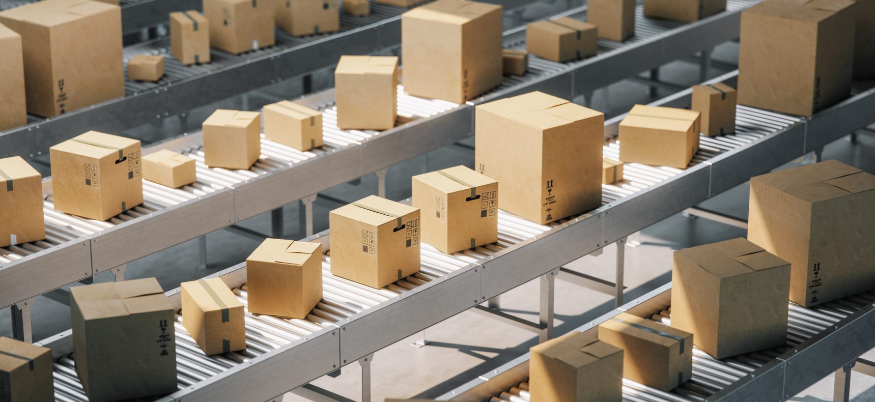 Cardboard boxes on conveyor belt in a distribution warehouse.